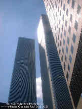 New York. A view of the World Trade Center Towers, standing right next to them.